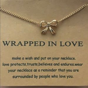 """Wrapped in love "" bow gold necklace"